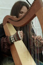 Harpist playing at a festival.